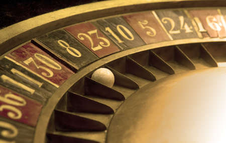 roulette wheels: Ball on and old roulette with numbers Stock Photo