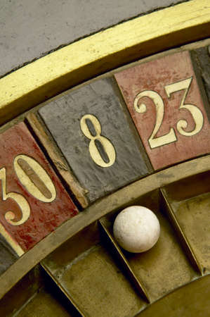 roulette wheels: Ball on a vintage roulette with numbers Stock Photo