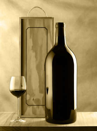 Wine bottle still life with glass of wine and wood box bi tone photo
