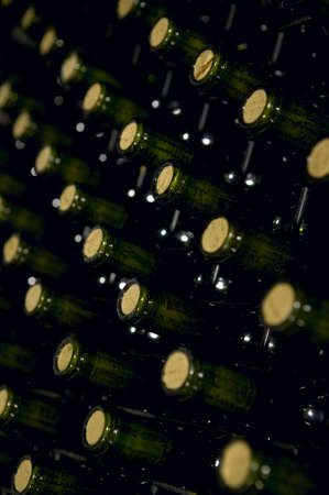 Large group of wine bottles in perspective at spanish cellar vertical photo