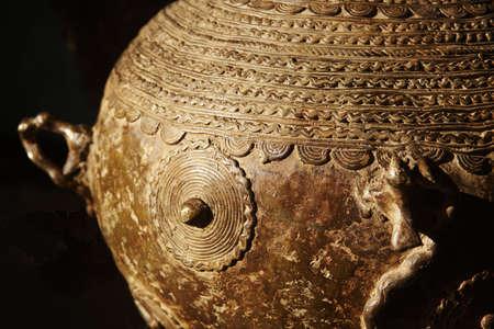 primitivism: Oriental decorated jar detail close up low key Stock Photo
