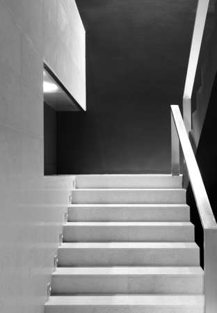 Modern office building interior detail of staircase black and white vertical photo