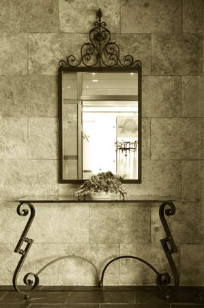 Mirror detail of a Luxury Hotel lobby with morning light bi tone vertical