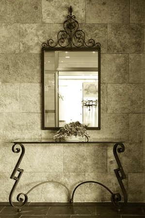 bi: Mirror detail of a Luxury Hotel lobby with morning light bi tone vertical