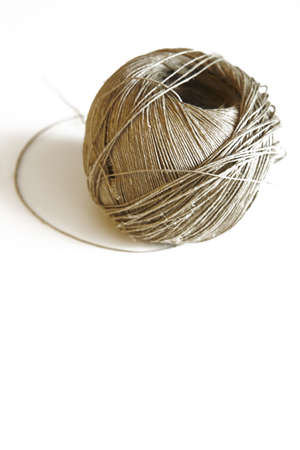 bonding rope: Ball of a twine on a white background vertical