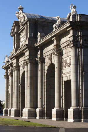 iluminate: Historical monument Alcala Gate in Madrid city vertical Stock Photo