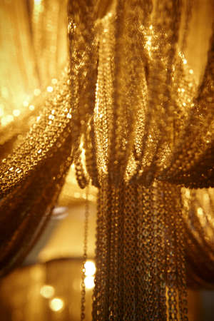 Long and wide chain curtains gold tone vertical  photo