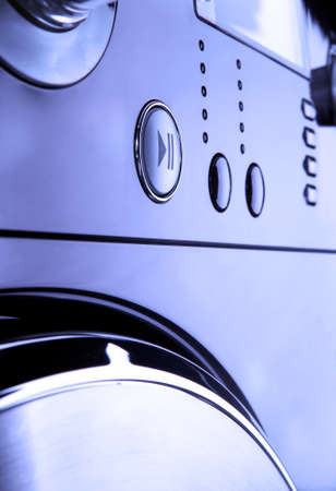 pannel: Close up of a modern washing machine control pannel, with timer and options low key blue tone