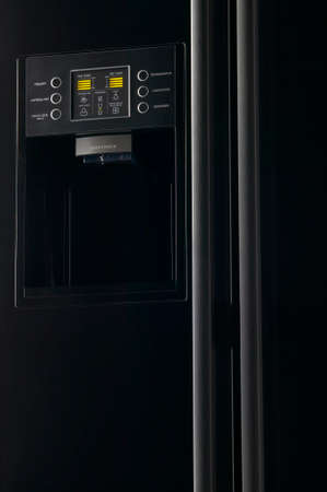 Modern black refrigerator with frontal display control panel low key