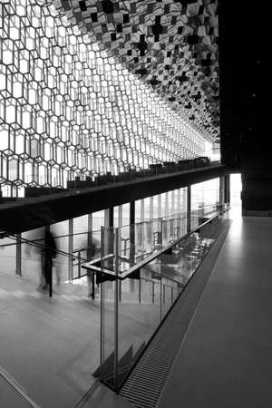 Facade detail and interior of Harpa Concert Hall in Reykjavik vertical black and white
