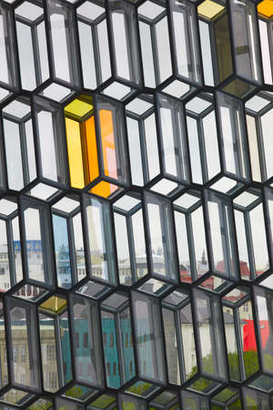Facade detail of Harpa Concert Hall with view of Reykjavik across the windows vertical