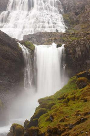 Fjallfoss waterfall on volcanic aerea in Dynjandivogur Bay Iceland vertical image