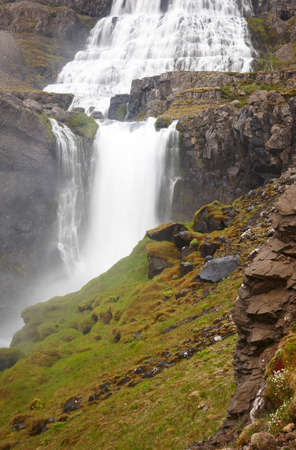 aerea: Fjallfoss waterfall on volcanic aerea in Dynjandivogur Bay Iceland vertical image