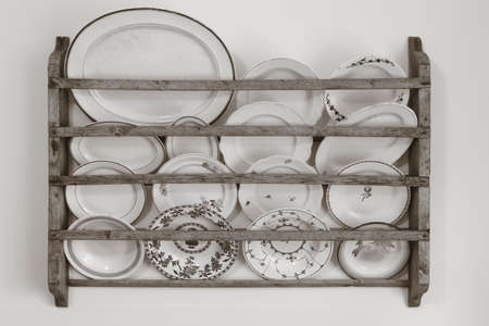 antique dishes: Antique ceramic dishes and wooden kitchen shelf