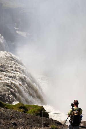 Gullfoss waterfall in Iceland Golden Circle with photographer photo