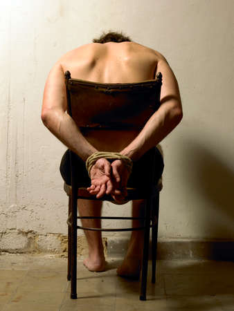 political prisoner: Man with tied hands color vertical image Stock Photo