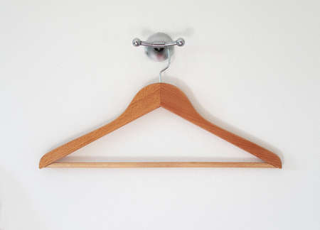 Wood Hanger and holder on a white wall