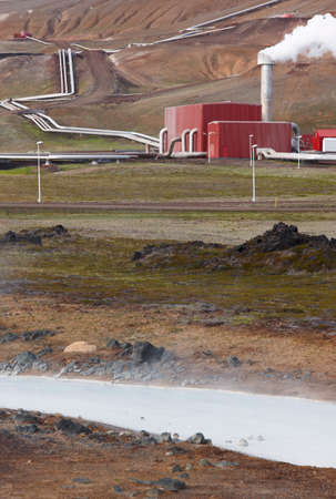 Landscape with geothermical pipes in Krafla aerea Iceland vertical image Stock Photo