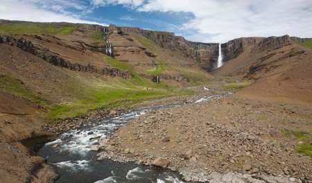 Waterfall and river in Hengifoss valley, Iceland East fjords  Lagarfljot area photo