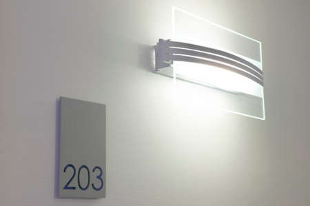 Hotel 203 Room number and corridor light  Stock Photo
