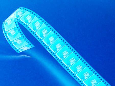 blue toned: Cinema background negative film reel blue toned Stock Photo