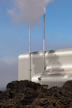 Geothermal power station on volcanic rocks landscape in Iceland photo