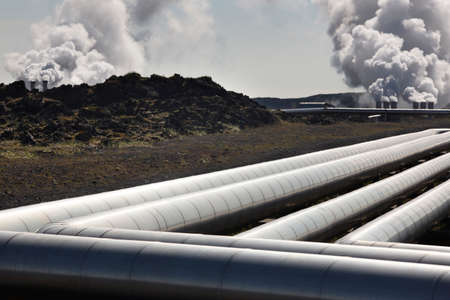 Geothermal pipes and power station on volcanic rocks landscape in Iceland photo