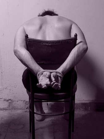 tortured: Man with tied hands bi tone vertical image