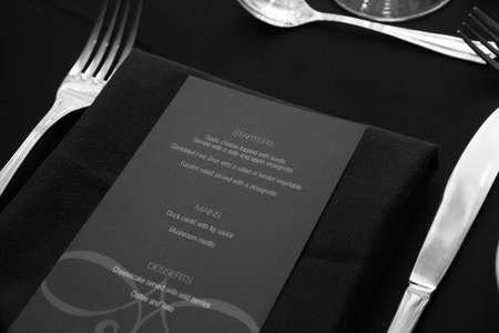 Restaurant menu on table for guests black and white Stock Photo