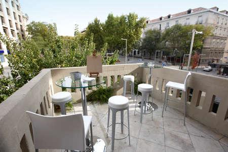 angle bar: Small patio bar with city view wide angle horizontal