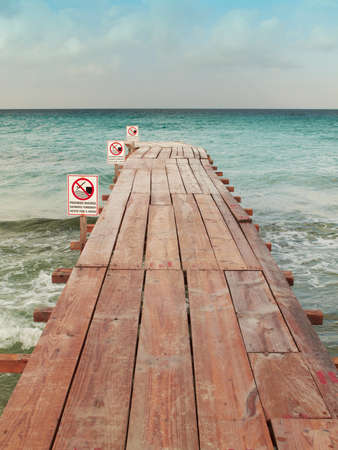Beach dock with signals  No swimming  Vertical                            photo