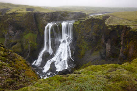 Iceland Landscape with waterfall and basaltic rocks