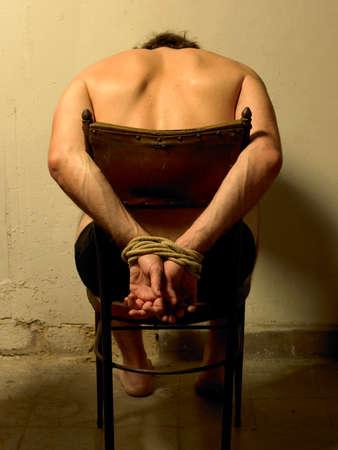 torture: Torture man with tide hands  Vertical  Warm light
