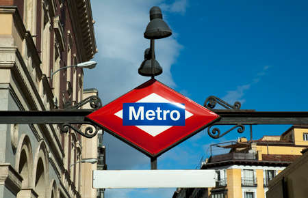 Metro sign station and classic buildings  Spain