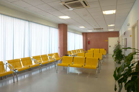 Hospital waiting area with yellow metallic chairs  Horizontal