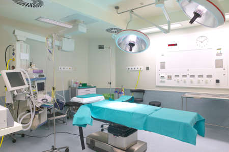 operating table: Surgery room with bed an machinery  Horizontal