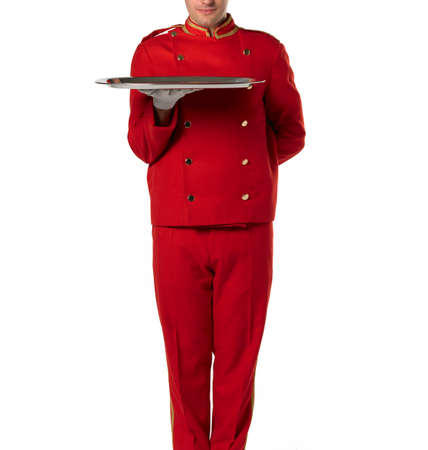 Bellboy with tray and red suit isolated on white