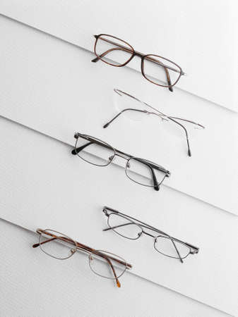 Various eyeglasses over a white background  Vertical Stock Photo - 27896910