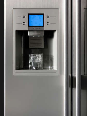 Fridge detail with ice dispenser and glass  Vertical photo