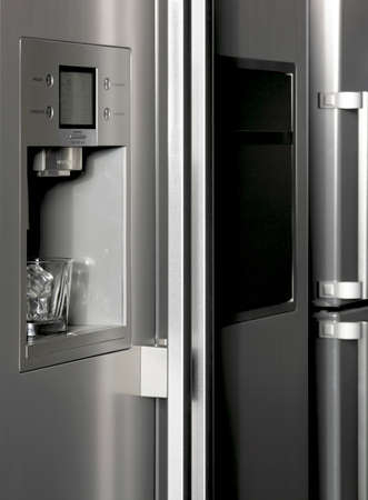 refrigerated: Fridge detail with ice dispenser and glass  Vertical Stock Photo