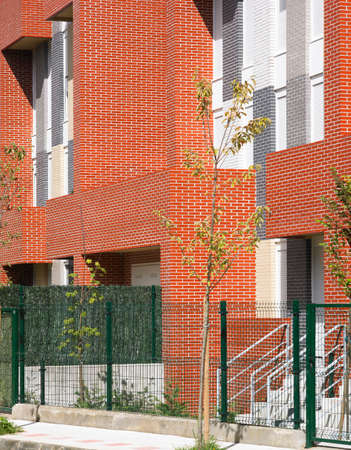 Residential building with red and grey brick facade  Horizontal photo