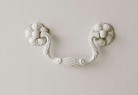 Detail of a drawer handle decorated on white  Horizontal                           photo