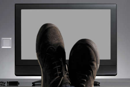 TV and shoes out of focus with neutral photo