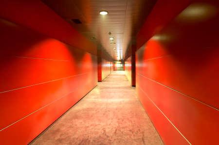Modern building red corridor with metallic walls  Horizontal photo