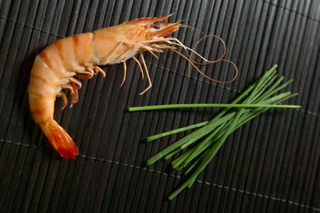 gambas: Cooked shrimp with black and green plants  Horizontal Stock Photo
