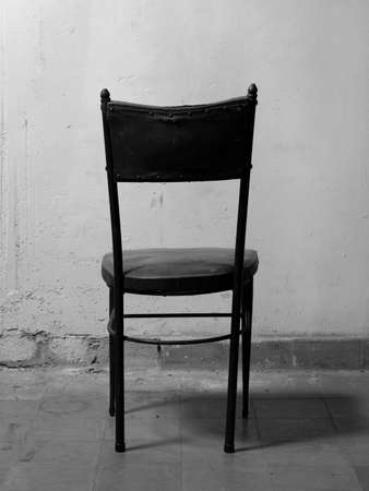 dirty room: Old chair in a dirty room  Black and white tone  Vertical format