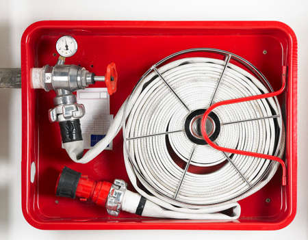 Fire hose equipment in a red metallic box  Horizontal