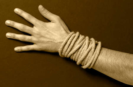 Man with a rope in his hand  Sepia tone  Horizontal photo