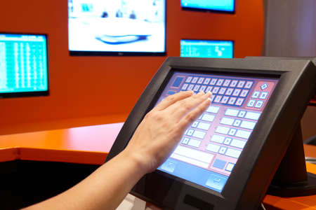 Bet machine with female hand ready to operate  Horizontal photo