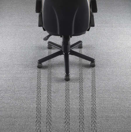 tire marks: Office chair with tire marks in the carpet  Horizontal Stock Photo